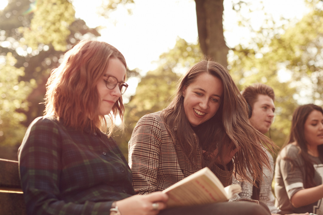 Students reading a book at barnes park
