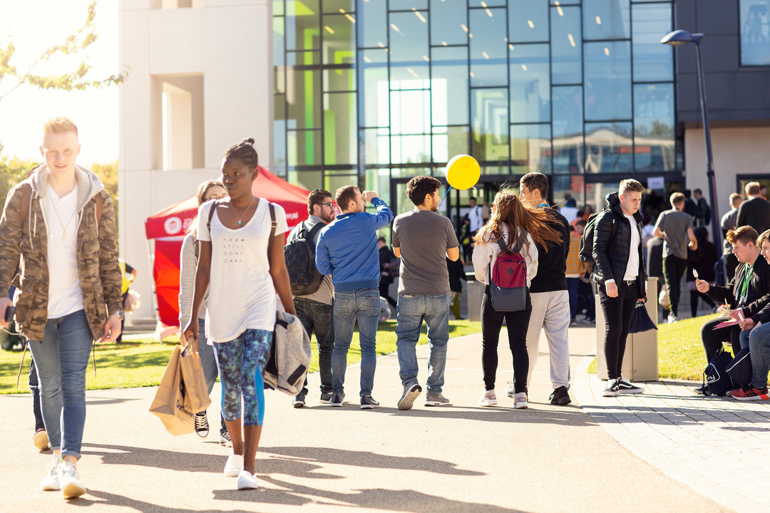 Image of students walking around the Welcome Fair